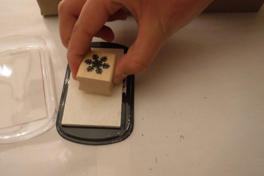 Snowflake stamp on white ink pad